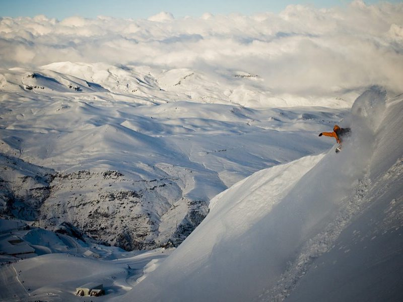 dakine snowboarding with powderquest