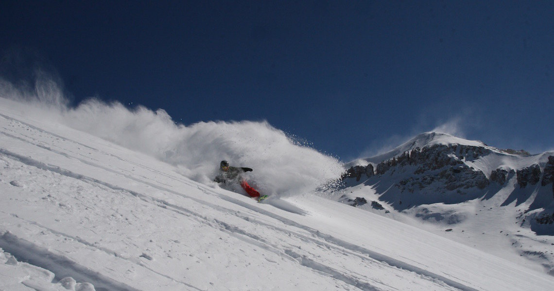 Slashing fresh pow in the back side of Valle Nevado, Chile